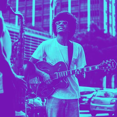 Man on street playing guitar